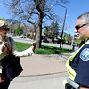 "University of Colorado junior Lindsay Hellmuth shows her school identification card to Boulder Police officer Gary Stevens to gain access to campus near the intersection of Broadway and 18th Street  on April 20, 2012. The campus is closed to the public and only open to students. For more photos and video of 4/20 on the CU campus in Boulder go to  <a href=""http://www.dailycamera.com"">http://www.dailycamera.com</a><br /> Jeremy Papasso/ Camera"