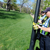"Jefferson County Sheriff deputies Seth Poe, right, and Paul Heger work to put up police tape to close off the Norlin Quad on the University of Colorado campus in Boulder on April 20, 2012. For more photos and video of 4/20 on the CU campus in Boulder go to  <a href=""http://www.dailycamera.com"">http://www.dailycamera.com</a><br /> Jeremy Papasso/ Camera"