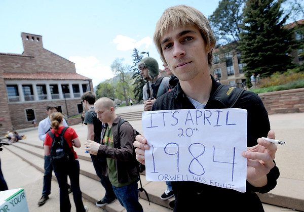 """CU student, John Demopoulos, holds up a sign concerning his feelings for the police on campus on 4/20.<br /> For more photos and videos of 4/20,  go to  <a href=""""http://www.dailycamera.com"""">http://www.dailycamera.com</a><br />  Cliff Grassmick / April 20, 2012"""