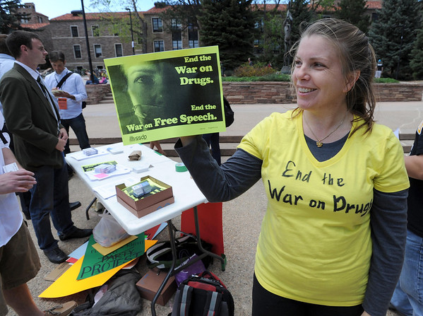 "Laura Schneider, a CU law student, was part of other law students who set up a protest with information at the Dalton Trumbo Fountain area Friday afternoon.<br /> For more photos and videos of 4/20,  go to  <a href=""http://www.dailycamera.com"">http://www.dailycamera.com</a><br />  Cliff Grassmick / April 20, 2012"