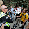 "The 4/20 protesters hit a wall at Norlin quad. Daniel Schwartz, right, has a conversation with a police officer. They decided to try Farand Field on the CU campus.<br /> For more photos and videos of 4/20,  go to  <a href=""http://www.dailycamera.com"">http://www.dailycamera.com</a><br />  Cliff Grassmick / April 20, 2012"