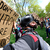 "An unidentified man in a gas mask holds a sign supporting the 4/20 rally after marching across the University of Colorado campus in Boulder on Friday, April 20. For more photos and video go to  <a href=""http://www.dailycamera.com"">http://www.dailycamera.com</a><br /> Jeremy Papasso/ Camera"