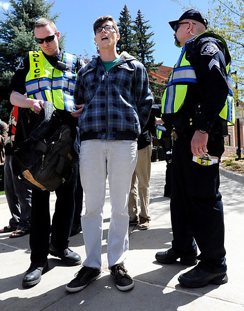 "University of Colorado senior Jonathan Edwards is arrested by Boulder County Sheriff deputies for trespassing on Norlin Quad by going past the police tape on the University of Colorado campus in Boulder on April 20, 2012. For more photos and video of 4/20 on the CU campus in Boulder go to  <a href=""http://www.dailycamera.com"">http://www.dailycamera.com</a><br /> Jeremy Papasso/ Camera"