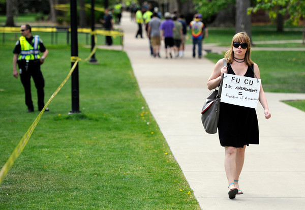 """University of Colorado graduate Marni LaFleur walks next to the Norlin Quad holding a sign supporting the first amendment during the 4/20 rally on the University of Colorado campus in Boulder on Friday, April 20. For more photos and video go to  <a href=""""http://www.dailycamera.com"""">http://www.dailycamera.com</a><br /> Jeremy Papasso/ Camera"""