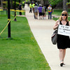 "University of Colorado graduate Marni LaFleur walks next to the Norlin Quad holding a sign supporting the first amendment during the 4/20 rally on the University of Colorado campus in Boulder on Friday, April 20. For more photos and video go to  <a href=""http://www.dailycamera.com"">http://www.dailycamera.com</a><br /> Jeremy Papasso/ Camera"