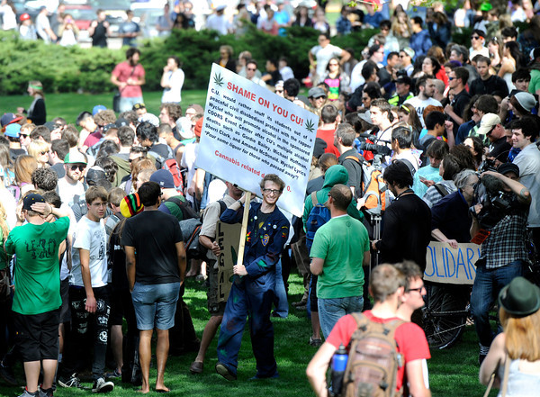 """Marijuana supporters gather outside of the Duane Physics building  during the 4/20 rally on the University of Colorado campus in Boulder on Friday, April 20. For more photos and video go to  <a href=""""http://www.dailycamera.com"""">http://www.dailycamera.com</a><br /> Jeremy Papasso/ Camera"""
