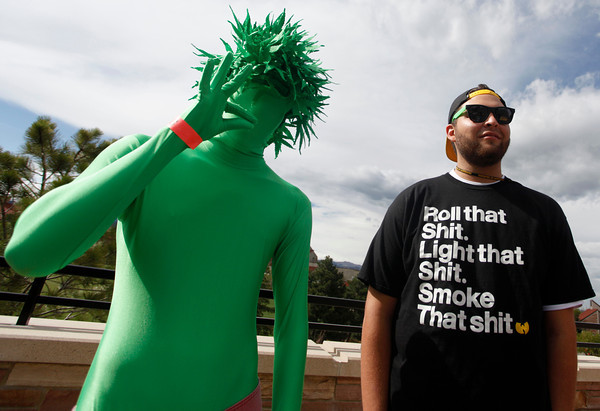 "Man on left, who refused to give his name, and Paul Silva, right, stand out side of the Coors Event Center on Friday, April, 20, 2012, in Boulder. They left the concert before Wyclef Jean took the stage.<br /> Photo by Derek Broussard<br /> For more photos and video visit  <a href=""http://www.dailycamera.com"">http://www.dailycamera.com</a>"