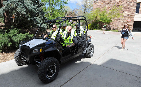 "Police and security ride around the CU campus on Friday.<br /> For more photos and videos of 4/20,  go to  <a href=""http://www.dailycamera.com"">http://www.dailycamera.com</a><br />  Cliff Grassmick / April 20, 2012"
