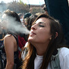 A young women smokes as the 4/20 celebration makes a brief happening oo the CU Boulder Campus late Friday afternoon April 20, 2012. <br /> <br /> Photo by Lewis Geyer   /  The Camera