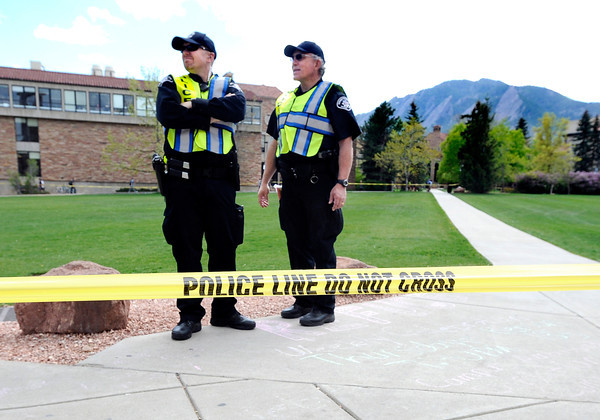 "Boulder County Sheriff deputies Eric Mayes, left, and Doug Caven patrol the Norlin Quad to make sure nobody trespasses during the 4/20 rally on the University of Colorado campus in Boulder on Friday, April 20. For more photos and video go to  <a href=""http://www.dailycamera.com"">http://www.dailycamera.com</a><br /> Jeremy Papasso/ Camera"