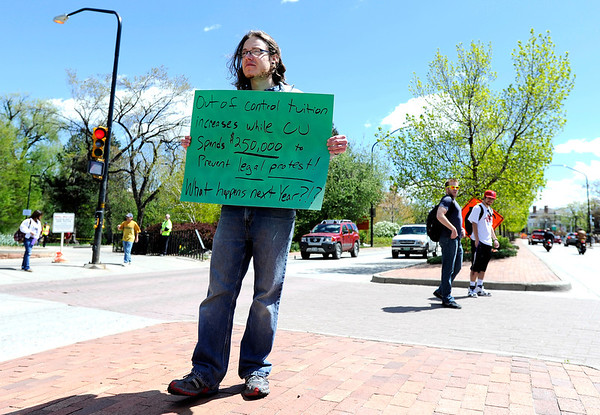 "Joshua Buggy, of Boulder, holds a sign supporting the 4/20 rally in the median at the intersection of Broadway and Pennsylvania Avenue in front of the CU campus in Boulder on April 20, 2012. For more photos and video of 4/20 on the CU campus in Boulder go to  <a href=""http://www.dailycamera.com"">http://www.dailycamera.com</a><br /> Jeremy Papasso/ Camera"
