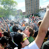"A crowd of marijuana supporters light up at 4:20 p.m. outside the Duane Physics building during the 4/20 rally on the University of Colorado campus in Boulder on Friday, April 20. For more photos and video go to  <a href=""http://www.dailycamera.com"">http://www.dailycamera.com</a><br /> Jeremy Papasso/ Camera"