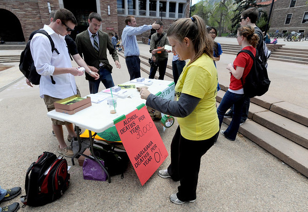 """University of Colorado law students  set up a protest with information at the Dalton Trumbo Fountain area Friday afternoon.<br /> <br /> For more photos and videos of 4/20,  go to  <a href=""""http://www.dailycamera.com"""">http://www.dailycamera.com</a><br />  Cliff Grassmick / April 20, 2012"""
