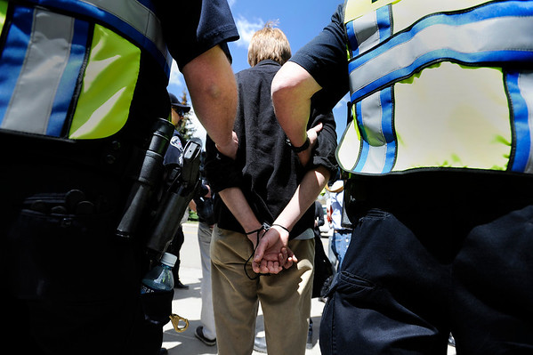 "University of Colorado senior John Demopoulos is detained by police after trespassing on the Norlin Quad on the University of Colorado campus in Boulder on April 20, 2012. For more photos and video of 4/20 on the CU campus in Boulder go to  <a href=""http://www.dailycamera.com"">http://www.dailycamera.com</a><br /> Jeremy Papasso/ Camera"