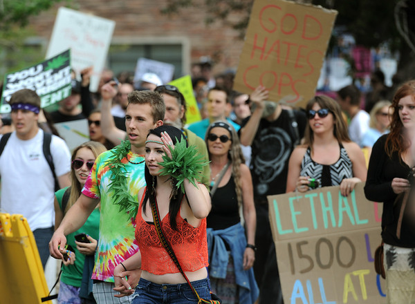 """Demonstrators walk from the Norlin Quadrangle to the field behind the Duane Physics building during the 4/20 demonstration Friday, April, 20, 2012.<br /> Photo by Lewis Geyer<br /> For more photos and video visit  <a href=""""http://www.dailycamera.com"""">http://www.dailycamera.com</a>"""