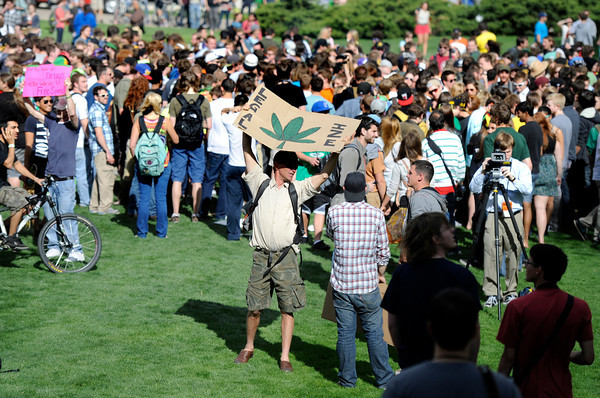 "A marijuana supporter holds a sign next to the crowd outside of the Duane Physics building during the 4/20 rally on the University of Colorado campus in Boulder on Friday, April 20. For more photos and video go to  <a href=""http://www.dailycamera.com"">http://www.dailycamera.com</a><br /> Jeremy Papasso/ Camera"