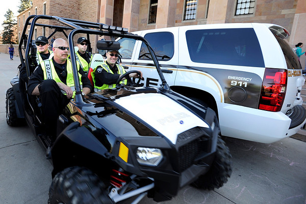 "Police officers patrol the University of Colorado in an ATV on the CU campus in Boulder on Friday, April 20. CU has closed its campus to the public, only allowing students or people with permits enter the premises in order to stop the 4/20 rally from happening. For more photos and video of the 4/20 event go to  <a href=""http://www.dailycamera.com"">http://www.dailycamera.com</a><br /> Jeremy Papasso/ Camera"