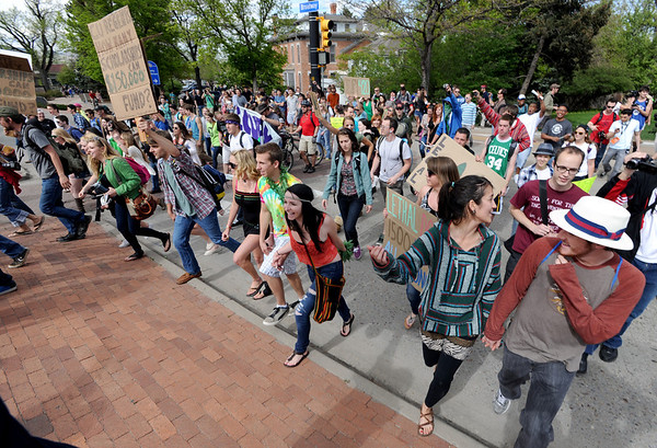 "Hundreds of protesters cross over Broadway to The Hill to make their point.<br /> For more photos and videos of 4/20,  go to  <a href=""http://www.dailycamera.com"">http://www.dailycamera.com</a><br />  Cliff Grassmick / April 20, 2012"