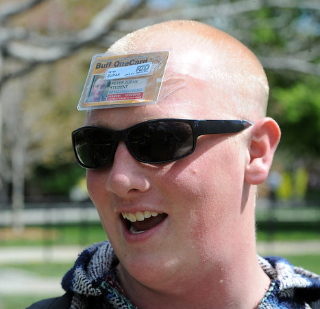 "Peter Zupan wore his ID on his head in protest.<br /> For more photos and videos of 4/20,  go to  <a href=""http://www.dailycamera.com"">http://www.dailycamera.com</a><br />  Cliff Grassmick / April 20, 2012"