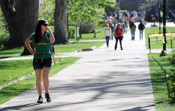 """CU student Danielle Slusher holds her nose while walking through campus Friday morning. <br /> For more photos and videos of 4/20,  go to  <a href=""""http://www.dailycamera.com"""">http://www.dailycamera.com</a><br />  Cliff Grassmick / April 20, 2012"""