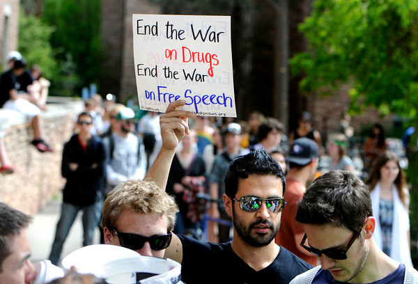 "Nick Peterson holds a sign supporting free speech during the 4/20 rally on the University of Colorado campus in Boulder on Friday, April 20. For more photos and video go to  <a href=""http://www.dailycamera.com"">http://www.dailycamera.com</a><br /> Jeremy Papasso/ Camera"