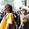 Daniel Schwartz  encourages a crowd to surround the Norlin Quad as a protest on the University of Colorado Boulder Campus  Friday afternoon April 20, 2012. Leaders of the crowd changed their mind and marched to Farrand Field<br /> <br /> Photo by Paul Aiken   /  The Camera