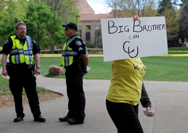 "Laura Schneider, a CU law students makes a point about the police presence on campus on Friday.<br /> For more photos and videos of 4/20,  go to  <a href=""http://www.dailycamera.com"">http://www.dailycamera.com</a><br />  Cliff Grassmick / April 20, 2012"