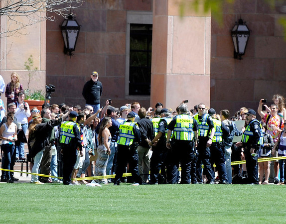 "Police arrest three University of Colorado seniors after trespassing on the Norlin Quad on the University of Colorado campus in Boulder on April 20, 2012. For more photos and video of 4/20 on the CU campus in Boulder go to  <a href=""http://www.dailycamera.com"">http://www.dailycamera.com</a><br /> Jeremy Papasso/ Camera"