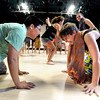 "Kevin Nguyen, left, and Elizabeth Neuhauser, right, dance together on their hands and knees during the Maymester African Dance class final on Friday, June 1, at the University of Colorado Dance and Theatre building on the CU campus in Boulder. For more photos and video of the dance go to  <a href=""http://www.dailycamera.com"">http://www.dailycamera.com</a><br /> Jeremy Papasso/ Boulder Daily Camera"