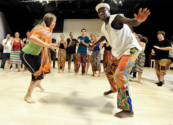 """Heidi Guenther, left, imitates the moves of instructor Nii Armah Sowah during the Maymester African Dance class final on Friday, June 1, at the University of Colorado Dance and Theatre building on the CU campus in Boulder. For more photos and video of the dance go to  <a href=""""http://www.dailycamera.com"""">http://www.dailycamera.com</a><br /> Jeremy Papasso/ Boulder Daily Camera"""