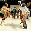 "Heidi Guenther, left, imitates the moves of instructor Nii Armah Sowah during the Maymester African Dance class final on Friday, June 1, at the University of Colorado Dance and Theatre building on the CU campus in Boulder. For more photos and video of the dance go to  <a href=""http://www.dailycamera.com"">http://www.dailycamera.com</a><br /> Jeremy Papasso/ Boulder Daily Camera"