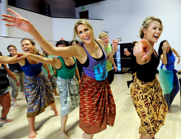 "Claire Runge, middle, and Lynsey Colden, left, participate in a dance during the Maymester's African Dance class final on Friday, June 1, at the University of Colorado Dance and Theatre building on the CU campus in Boulder. For more photos and video of the dance go to  <a href=""http://www.dailycamera.com"">http://www.dailycamera.com</a><br /> Jeremy Papasso/ Boulder Daily Camera"