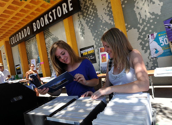 """CU students, Kelsey Young, and Lauren Harmon, look at the prints at the Colorado Boohstore on Sunday.<br /> The Colorado Bookstore on the Hill had a busy weekend with students preparing for the first day of classes.<br /> For more photos and a video, go to  <a href=""""http://www.dailycamera.com"""">http://www.dailycamera.com</a>.<br /> Cliff Grassmick / August 22, 2010"""