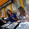 "CU students, Kelsey Young, and Lauren Harmon, look at the prints at the Colorado Boohstore on Sunday.<br /> The Colorado Bookstore on the Hill had a busy weekend with students preparing for the first day of classes.<br /> For more photos and a video, go to  <a href=""http://www.dailycamera.com"">http://www.dailycamera.com</a>.<br /> Cliff Grassmick / August 22, 2010"