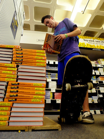 """CU student , Zach Visger, looks over Spanish books at the Colorado Bookstore.The Colorado Bookstore on the Hill had a busy weekend with students preparing for the first day of classes.<br /> For more photos and a video, go to  <a href=""""http://www.dailycamera.com"""">http://www.dailycamera.com</a>.<br /> Cliff Grassmick / August 22, 2010"""