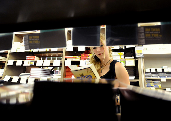 """CU student, Casey Moher, looks through language books at the Colorado Bookstore on Sunday.<br /> The Colorado Bookstore on the Hill had a busy weekend with students preparing for the first day of classes.<br /> For more photos and a video, go to  <a href=""""http://www.dailycamera.com"""">http://www.dailycamera.com</a>.<br /> Cliff Grassmick / August 22, 2010"""