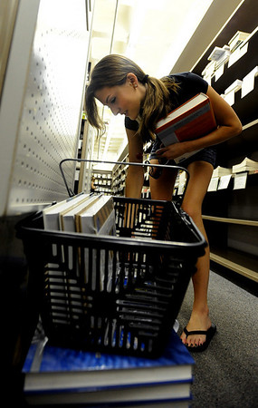 "CU Student, Breanna Stroh, looks through engineering books at the Colorado Bookstore on Sunday.The Colorado Bookstore on the Hill had a busy weekend with students preparing for the first day of classes.<br /> For more photos and a video, go to  <a href=""http://www.dailycamera.com"">http://www.dailycamera.com</a>.<br /> Cliff Grassmick / August 22, 2010"
