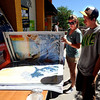 "CU students, Dana Foster, left, and Danny Fusco, check out prints and posters for their rooms. The Colorado Bookstore on the Hill had a busy weekend with students preparing for the first day of classes. <br /> For more photos and a video, go to  <a href=""http://www.dailycamera.com"">http://www.dailycamera.com</a>.<br /> Cliff Grassmick / August 22, 2010"