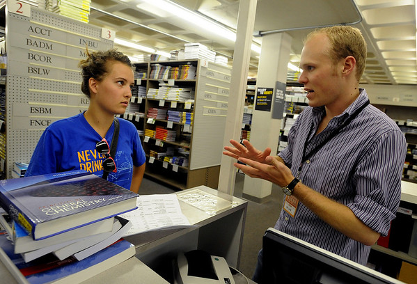 "CU student, Ava Ashby, listens to the advice of William Torrence, an employee of the Colorado Bookstore while finding books.<br /> The Colorado Bookstore on the Hill had a busy weekend with students preparing for the first day of classes.<br /> For more photos and a video, go to  <a href=""http://www.dailycamera.com"">http://www.dailycamera.com</a>.<br /> Cliff Grassmick / August 22, 2010"