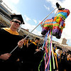 John Kaplar, a Master's degree candidate, holds a pinata during the ceremony.<br /> The University of Colorado conferred 5,825 degrees at Folsom Field Friday, May 7, 2010.<br /> Cliff Grassmick / May 7, 2010