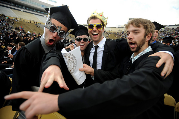 Spencer Goldstein, left, Jimmy Silverwood, Max Barrett, and Tyler Cole, ham it up for the camera.<br /> The University of Colorado conferred 5,825 degrees at Folsom Field Friday, May 7, 2010.<br /> Cliff Grassmick / May 7, 2010