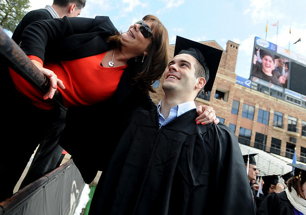 Debbie Crawford poses for a photo with her son, graduate Casey.<br /> The University of Colorado conferred 5,825 degrees at Folsom Field Friday, May 7, 2010.<br /> Cliff Grassmick / May 7, 2010