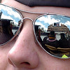 The CU  graduation scene is reflected in the sunglasses of this undergraduate.<br /> The University of Colorado conferred 5,825 degrees at Folsom Field Friday, May 7, 2010.<br /> Cliff Grassmick / May 7, 2010
