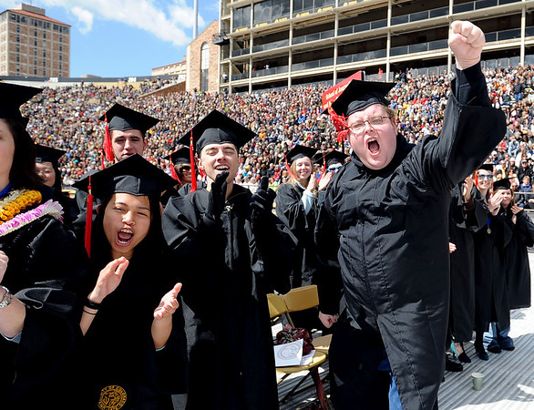 Charissee Clark, left,  Philip Thurner, and Adam Ladwig, all Journalism graduates, are excited about graduating.<br /> The University of Colorado conferred 5,825 degrees at Folsom Field Friday, May 7, 2010.<br /> Cliff Grassmick / May 7, 2010