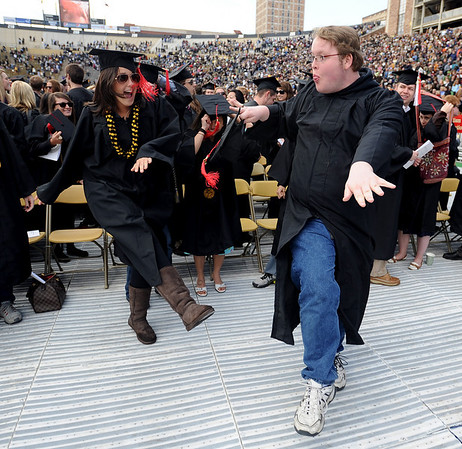 "Kelly Schuberth, left, and  Adam Ladwig, both Journalism graduates, dance to the song ""In the Mood,"" after the ceremony.<br /> The University of Colorado conferred 5,825 degrees at Folsom Field Friday, May 7, 2010.<br /> Cliff Grassmick / May 7, 2010"