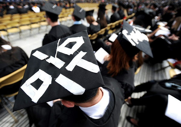 """I did it,"" says the cap of Dillon O'Kelley.<br /> The University of Colorado conferred 5,825 degrees at Folsom Field Friday, May 7, 2010.<br /> Cliff Grassmick / May 7, 2010"