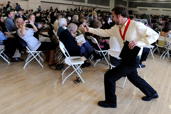 "Joel Gillin, right, poses for a photo for his sister, Kira, after he gets his honors medal.<br /> The University of Colorado College of Arts and Sciences held the Honors Program Convocation on Thursday at the Glenn Miller Ballroom.<br /> For more photos and a video of the convocation, go to  <a href=""http://www.dailycamera.com"">http://www.dailycamera.com</a><br /> Cliff Grassmick / May 6, 2010"