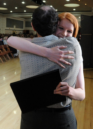 "CU economics professor Jeff Zax, hugs Nicole Voss.<br /> The University of Colorado College of Arts and Sciences held the Honors Program Convocation on Thursday at the Glenn Miller Ballroom.<br /> For more photos and a video of the convocation, go to  <a href=""http://www.dailycamera.com"">http://www.dailycamera.com</a><br /> Cliff Grassmick / May 6, 2010"