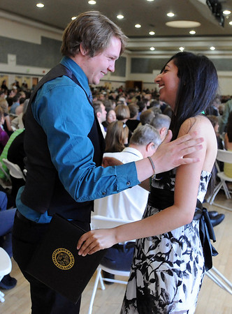 "Garrett Hedman, left, congratulates Bidita Dutta  after she received her  honors medal.<br /> The University of Colorado College of Arts and Sciences held the Honors Program Convocation on Thursday at the Glenn Miller Ballroom.<br /> For more photos and a video of the convocation, go to  <a href=""http://www.dailycamera.com"">http://www.dailycamera.com</a><br /> Cliff Grassmick / May 6, 2010"