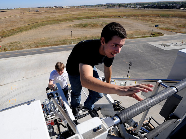 """Sean Lorman, right, and Nick Maston, get to the top of the fire truck ladder during a training exercise.<br /> The Boulder Fire Department hosted the Leadership Fire Academy for University of Colorado students from sororities, fraternities, student government, and other organizations in hopes of giving them life-saving information they care share with their peers.<br /> For more photos and a video, go to  <a href=""""http://www.dailycamera.com"""">http://www.dailycamera.com</a><br /> Cliff Grassmick / September 25, 2010"""